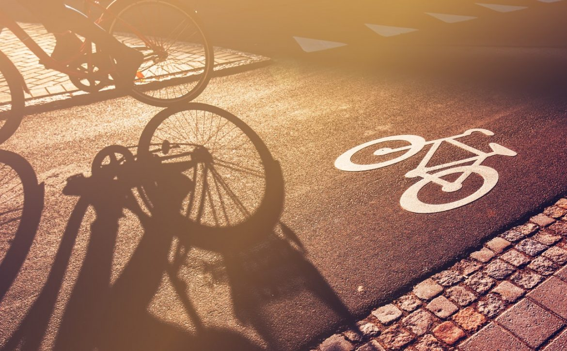 Shadow of cyclist on bicycle lane